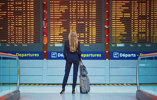 Lady in front of departures list
