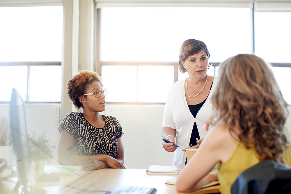 Three ladies in a meeting